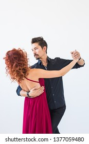 Social dance, bachata, kizomba, people concept - Young pretty woman in pink dress and man dancing waltz or salsa