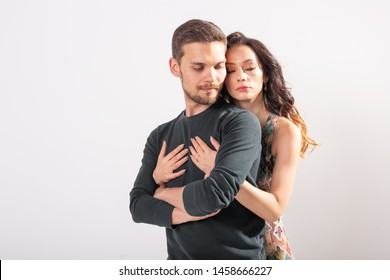 Social dance concept - Active happy adults dancing bachata together over white background with copy space