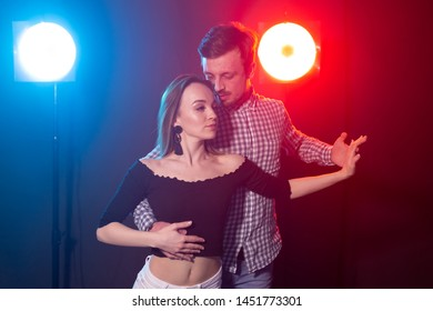 Social dance, kizomba, salsa, semba or zouk concept - a young couple dancing bachata and salsa at the disco