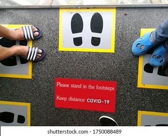 Social distance In the lift at thailand, Sign stands on lift To protect against Covid-19.