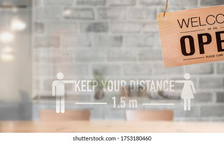 Social distance sign on window glass. Keep your distancing from other people. Coronavirus pandemic preventive measures.