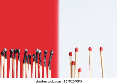 Social Distancing concept using burnt out match sticks as a metaphor for containing corona virus outbreak - Covid-19 outbreak concept