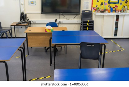 Social distancing measures in a school classroom with tape separating tables and chairs in response to the COVID-19 Coronavirus. London - 3rd June 2020