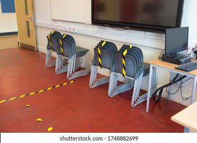 Social distancing measures in a school classroom with tape separating tables and chairs in response to the COVID-19 Coronavirus. London - 4th June 2020