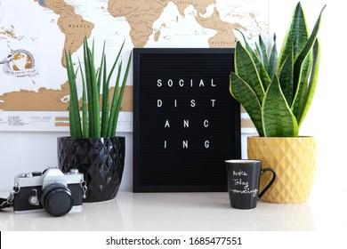 Social distancing message on black board