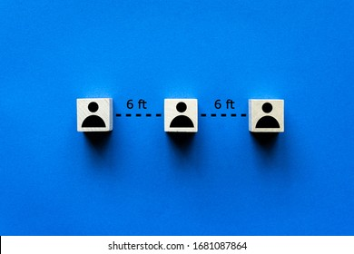 Social distancing people icons isolated on blue background for covid-19 spreading prevention