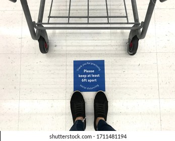 Social distancing sign in grocery store or retailer store  to  remind people to keep 6 feet distance from each others  during shelter in place due to Covid-19 or Coronavirus pandemic crisis