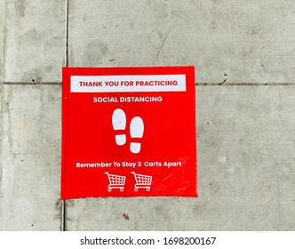 Social Distancing Sign on the Ground at Grocery Store Supermarket during COVID-19 Coronavirus Outbreak