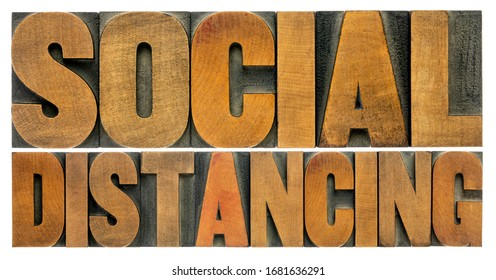 social distancing word abstract in vintage letterpress wood type, protective measures during covid-19 corona virus pandemic