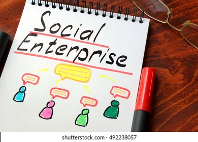 Social Enterprise written in a notepad with marker.