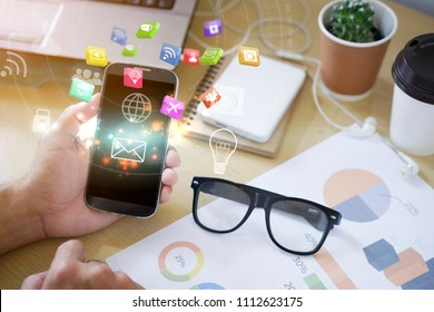 Social icons interface on smartphone, Social media concept