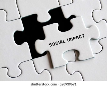 Social impact written on missing puzzle.
