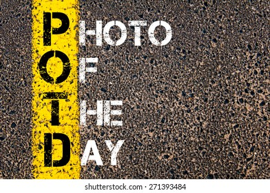 Social Media Acronym POTD as PHOTO OF THE DAY. Yellow paint line on the road against asphalt background. Conceptual image