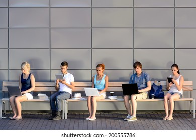 Social media addiction college students using laptop sitting in row