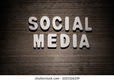 Social media concept wood letters on wooden background