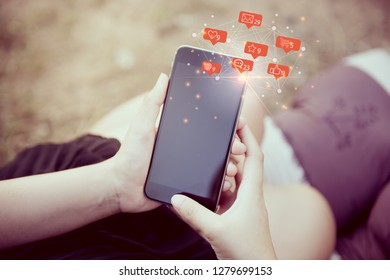 Social media concept.woman with smartphone outdoors in park. Closeup of female hands and smart phone on white screen ,sunlight
