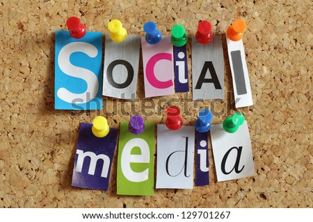 Social media from cutout newspaper headlines pinned to a cork bulletin board