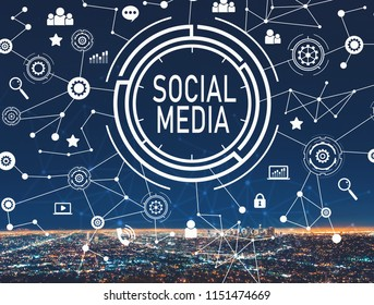 Social media with downtown Los Angeles at night