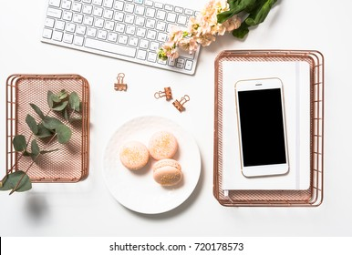 Social media feminine flat lay with orange macaroons, flowers an