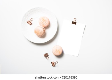 Social media flat lay with orange macaroons and postcard mock up