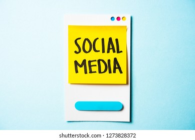 Social media, social network text with paper smart phone concept on blue background