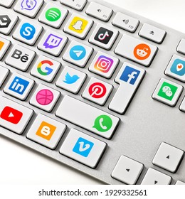 Social media are trending and both business as consumer are using it for information sharing and networking. Showing social media icons on a keyboard.