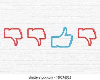 Social network concept: row of Painted red thumb down icons around blue thumb up icon on White Brick wall background