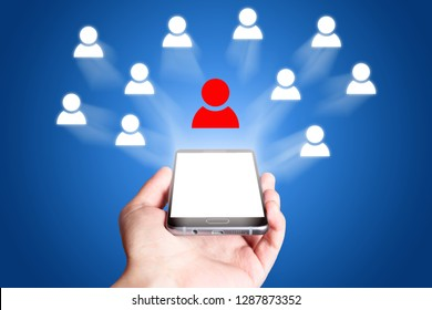 Social network icon. Mobile phone on blue background