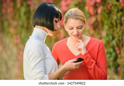 social network. just look at this. 3g 4g mobile internet surfing. digital marketing two happy women look in phone. buy online on cyber monday. black friday online shopping. business communication