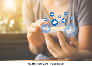 Social network sharing and commenting in the online community, Woman hand holding smartphone and using application social media