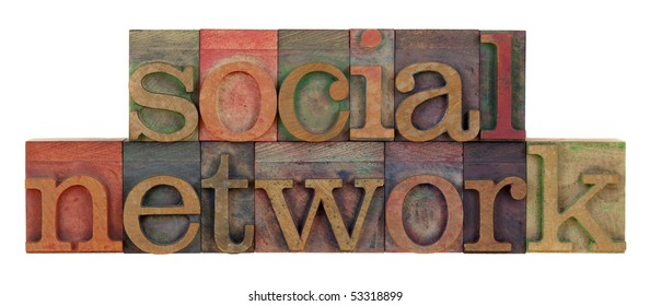 social network words in vintage wood letterpress type, stained by color ink, isolated on white