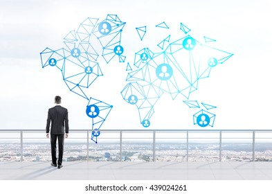 Social networking concept with thoughtful businessman looking at abstract network with people icons on city background