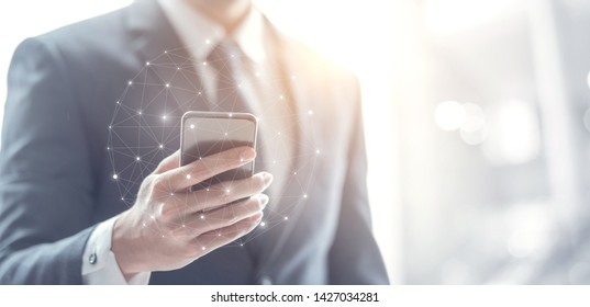 Social networking connection concept, Businessman hand using mobile phone and dots online communication network, copy space.