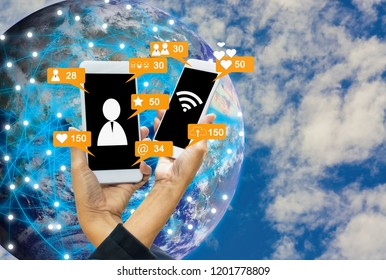 Social notification icon, smartphones in women's hands, globe and sky background, concept  linking everything to internet with things (iot) Elements of this image furnished by NASA