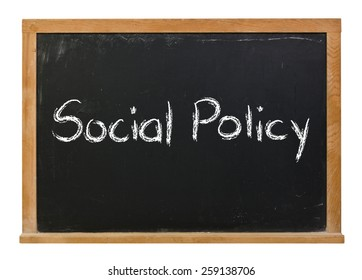 Social policy written in white chalk on a black chalkboard isolated on white