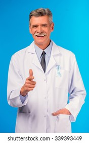 The social problem of male diseases. Portrait of a doctor with a blue ribbon. Isolated on a blue background