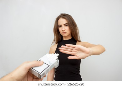 The social problem. Young unhappy woman, rejection box of cigarettes. negative attitude to smoking