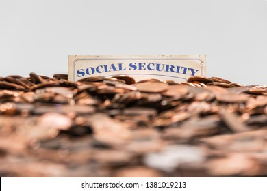 Social Security card buried in a mound of copper pennies.