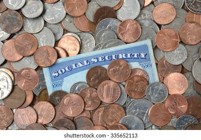 social security card laying in a pile of money