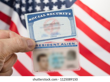 Social security card and resident alien card. Green card american dream concept