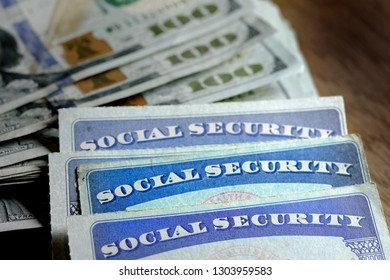 Social Security cards with cash money for savings and retirement