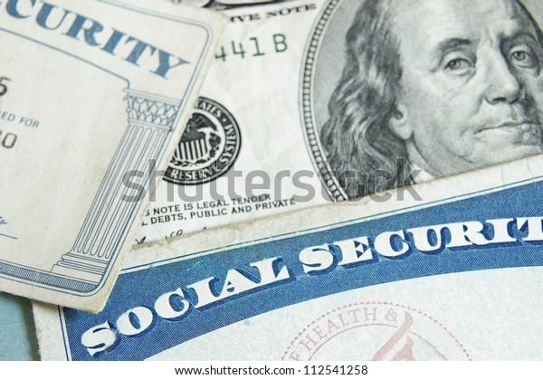 social security cards and US money - retirement concept