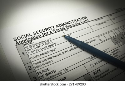 Social Security with a pen on top of paperwork