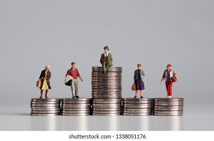 Social stratification concept. Miniature people with stack of coins.