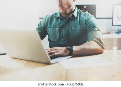 Social Trading Online Markets Analyze Reports.Men Working Wood Table Modern Interior Design Loft Place.Businessman Work Coworking Studio.Using Digital Tablet Hands.Blurred Background.Business Startup