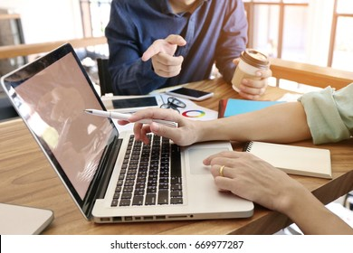 Social Trading Online Public Relations Director Analyze Reports.Guy working wood table Modern Interior Office.Businessman Work Coworking Studio.Using Digital Laptop.Blurred Background.Business Startup