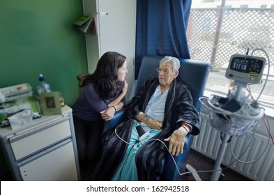 Social worker visit sick old male patient in hospital.Real people. Copy space