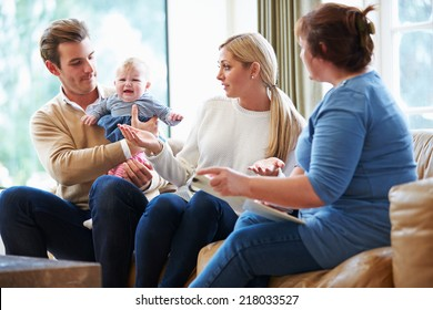 Social Worker Visiting Family With Young Baby
