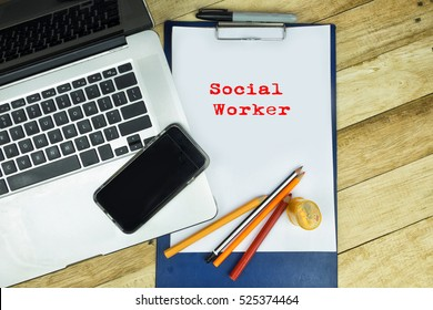 Social worker word at note pad in wooden table .