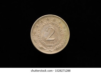 Socialist Federal Republic of Yugoslavia old 2 Dinara coin from 1972, reverse. Isolated on black background